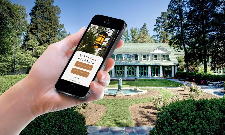 A mobile phone that displays the Reynolda Reveal website.
